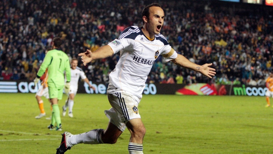 Los Angeles Galaxy forward Landon Donovan celebrates his goal as Houston Dynamo goalkeeper Tally Hall, left, walks away during the second half of the MLS Cup championship soccer match, Sunday, Nov. 20, 2011, in Carson, Calif. The Galaxy won 1-0. (AP Photo/Bret Hartman)