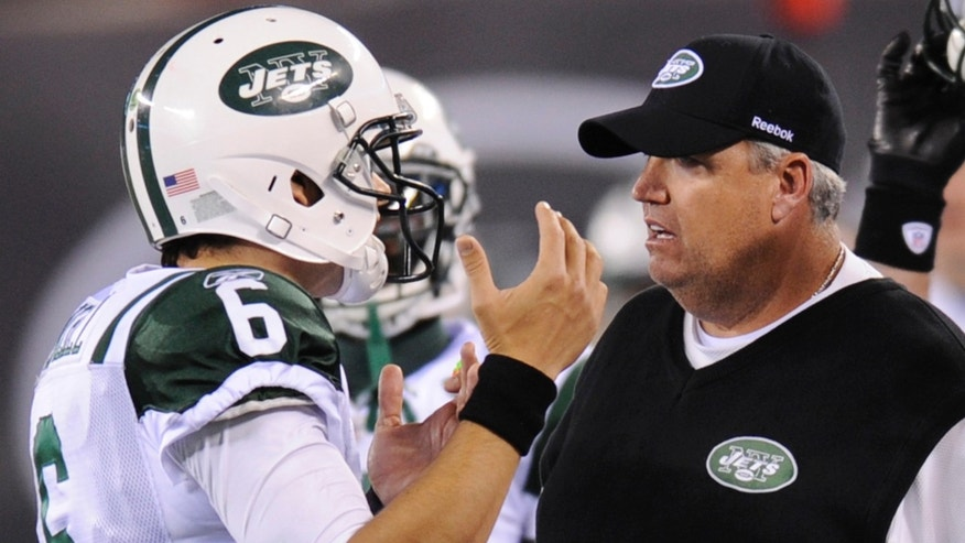 "This photo made Sunday, Nov. 13, 2011 shows New York Jets quarterback Mark Sanchez, left, talking with coach Rex Ryan after Sanchez took a time out in the second quarter of an NFL football game against the New England Patriots in East Rutherford, N.J.  Ryan told NBC at halftime that the timeout was the ""stupidest play in NFL history."" The Patriots defeated the Jets 37-16. (AP Photo/Bill Kostroun)"