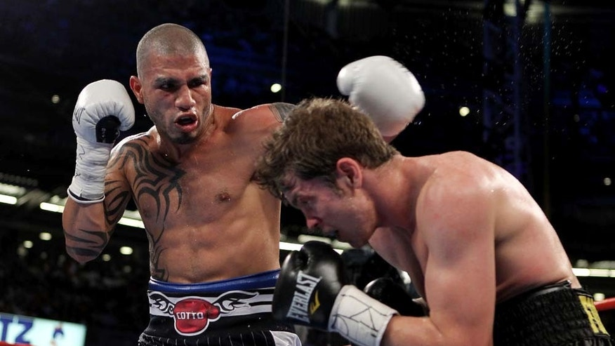 Miguel Cotto in fight pictured left.