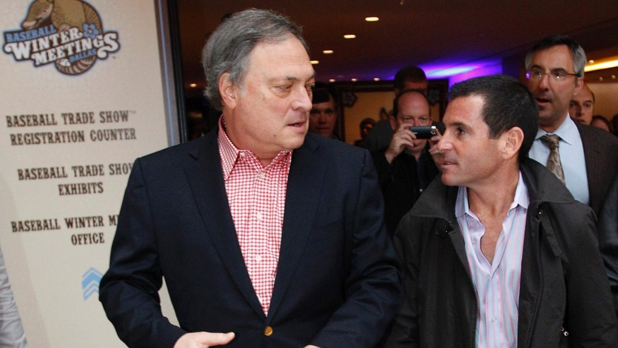 Florida Marlins owner Jeffrey Loria, left, and team president David Samson chat as they walk through the lobby of the hotel hosting Major League Baseball's winter meetings in Dallas,  Tuesday, Dec. 6, 2011.  (AP Photo/LM Otero)