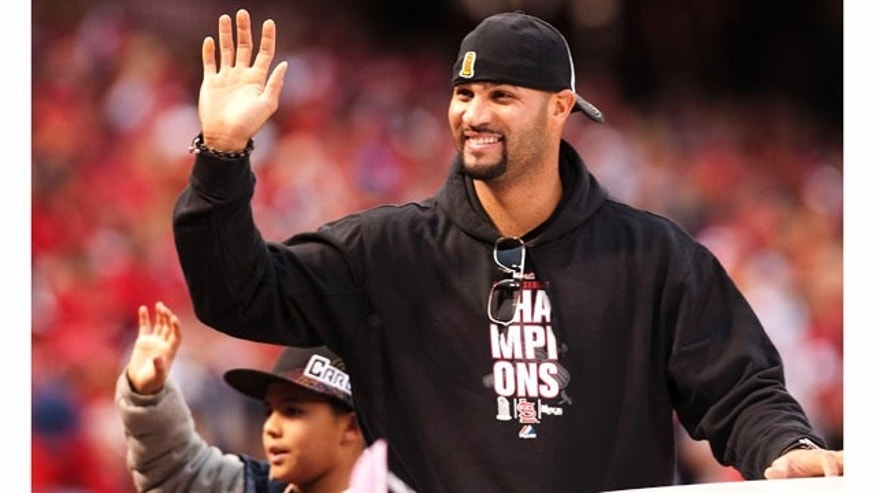 ST. LOUIS, MO - OCTOBER 30: First baseman Albert Pujols of the St. Louis Cardinals waves to the crowd during the World Series victory parade for the franchise's 11th championship on October 30, 2011 in St Louis, Missouri. The three-time MVP signed with the Los Angeles Angels of Anaheim on Dec. 8, 2011. (Photo by Ed Szczepanski/Getty Images)