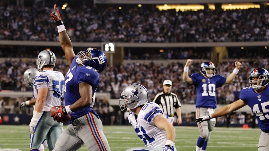 New York Giants' Brandon Jacobs scores the winning touchdown against the Dallas Cowboys during the second half of an NFL football game Sunday, Dec. 11, 2011, in Arlington, Texas. New York won 37-34. (AP Photo/Tony Gutierrez)