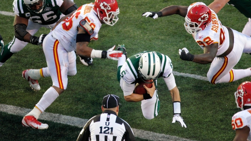 New York Jets quarterback Mark Sanchez, center, scores his second running touchdown during the third quarter of an NFL football game against the Kansas City Chiefs on Sunday, Dec. 11, 2011, in East Rutherford, N.J. (AP Photo/Seth Wenig)