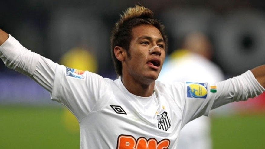 Brazil's Santos FC forward Neymar celebrates after scoring a goal against Japan's Kashiwa Reysol during the semifinal  at the Club World Cup soccer tournament  in Toyota, central Japan, Wednesday, Dec. 14, 2011.  (AP Photo/Shizuo Kambayashi)