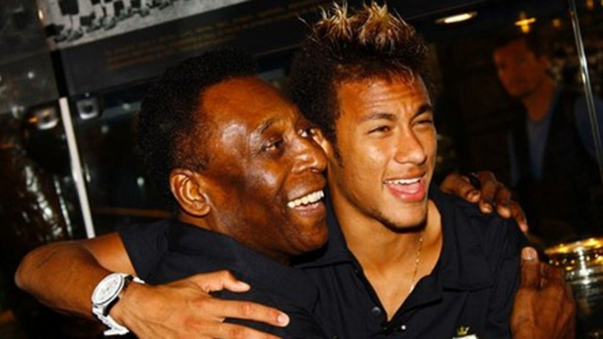 In this photo released by Santos Futebol Clube, former soccer player Pele, left, and Santos' soccer player Neymar smile as they pose for pictures during a press conference in Santos, Brazil, Wednesday, Nov. 30, 2011. Pele will perform in an ambassadorial role for club Santos during its centenary celebrations next year. (AP Photo/Ricardo Saibun-Santos)