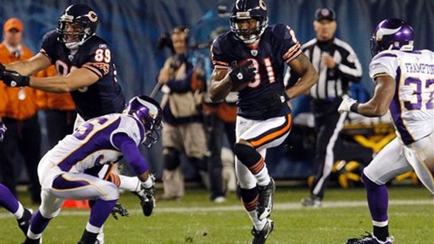 In this Oct. 16, 2011, file photo, Chicago Bears wide receiver Sam Hurd (81) rushed between Minnesota Vikings defenders during the second half of an NFL football game in Chicago.