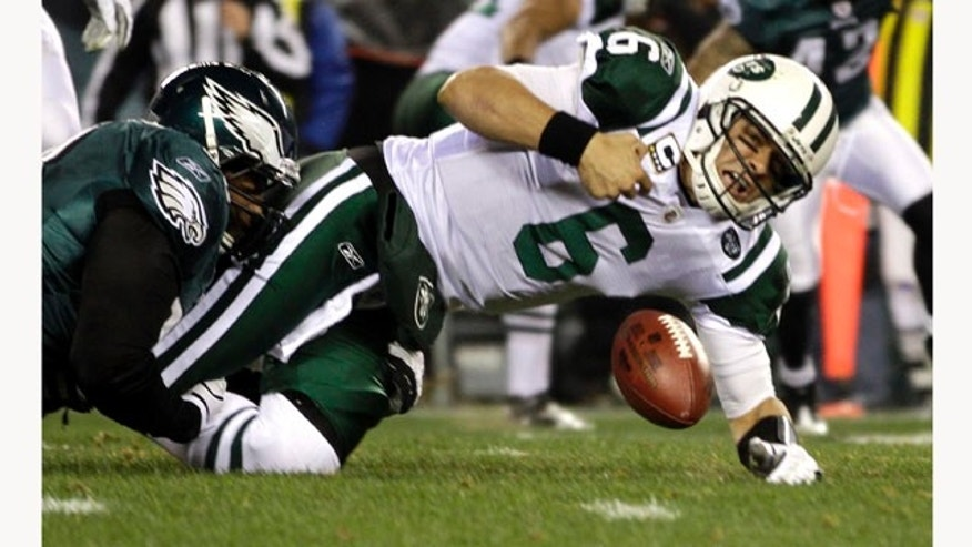 Philadelphia Eagles defensive tackle Mike Patterson, left, sacks New York Jets quarterback Mark Sanchez (6) to force a fumbles in the first half of an NFL football game Sunday, Dec. 18, 2011, in Philadelphia. (AP Photo/Matt Slocum)