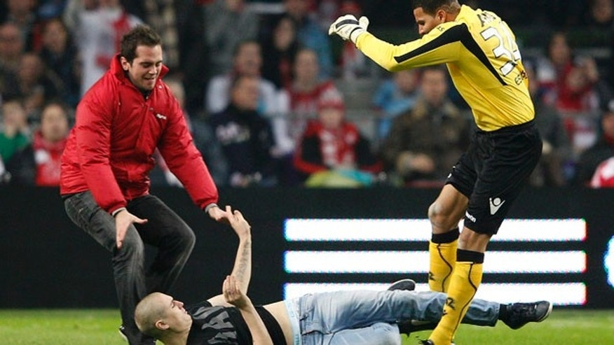 Dec. 21, 2011: Keeper Esteban Alvarado, right, kicks an attacker who rushed from the stands as referee Bas Nijhuis, left, runs towards them during a cup match between Ajax and AZ Alkmaar in Amsterdam, Netherlands.