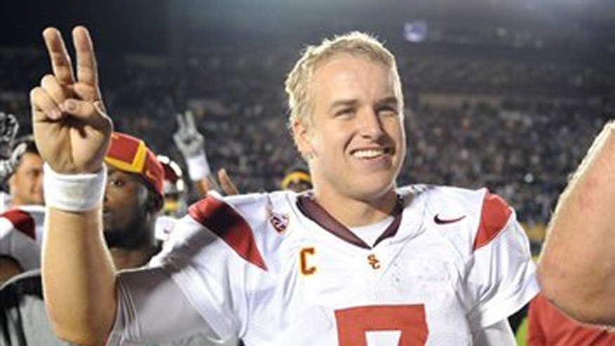 This Oct. 22, 2011 file photo shows Southern California quarterback Matt Barkley celebrating a 31-17 victory over Notre Dame, in South Bend, Ind.