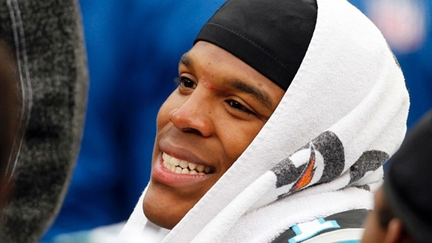 Dec. 24, 2011: Carolina Panthers quarterback Cam Newton smiles as he sits on the bench during the third quarter of the Panthers' 48-16 win over the Tampa Bay Buccaneers in an NFL football game in Charlotte, N.C.