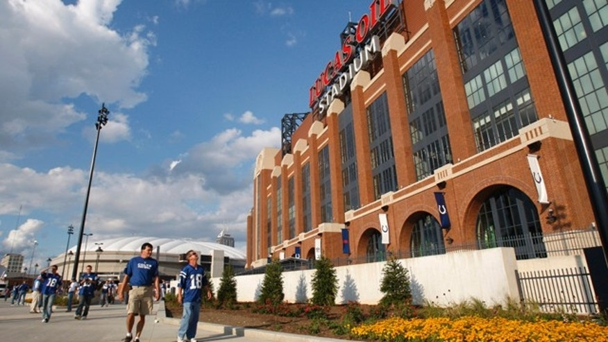 Sept. 7, 2008: Fans pass the new home of the Indianapolis Colts, Lucas Oils Stadium.