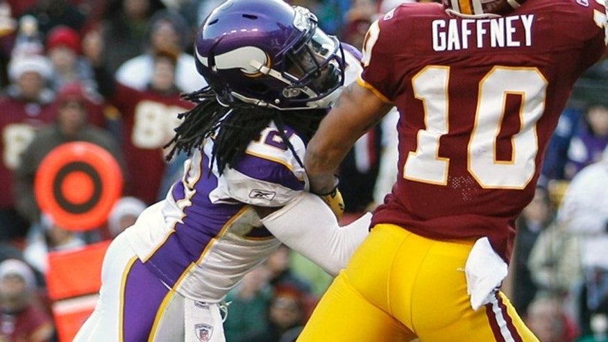 Dec. 24, 2011: Minnesota Vikings defensive back Benny Sapp, left, defends against a touchdown pass agaisnt the Redskins.