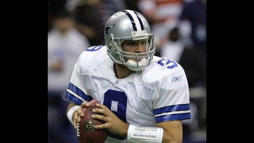 Dallas Cowboys quarterback Tony Romo (9) fades back looking for a receiver in the third quarter against the New York Giants in their football game in Irving, Texas, Monday, Oct. 23, 2006.  (AP Photo/L.M. Otero)