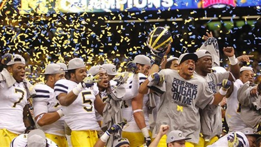 Jan. 3, 2012: Members of the Michigan football team celebrate after a 23-20 overtime win over Virginia Tech in the Sugar Bowl NCAA college football game in New Orleans.