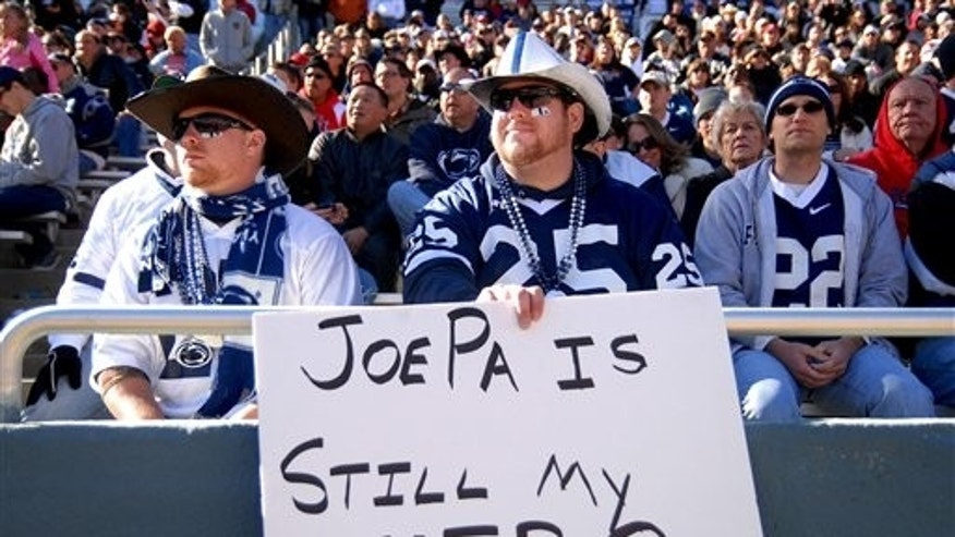 Jan. 2: A Penn State fan displays a sign supporting former Penn State head coach Joe Paterno during the TicketCity Bowl NCAA football game against Houston at the Cotton Bowl in Dallas.