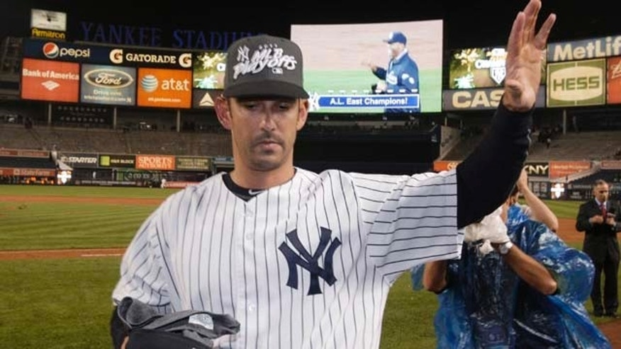 New York Yankees' Jorge Posada waves to fans as he leaves the field after the second game of a baseball doubleheader against the Tampa Bay Rays on Wednesday, Sept. 21, 2011, in New York. He said Wednesday that he doesn't expect to return to the Yankees in 2012. (AP Photo/Frank Franklin II)
