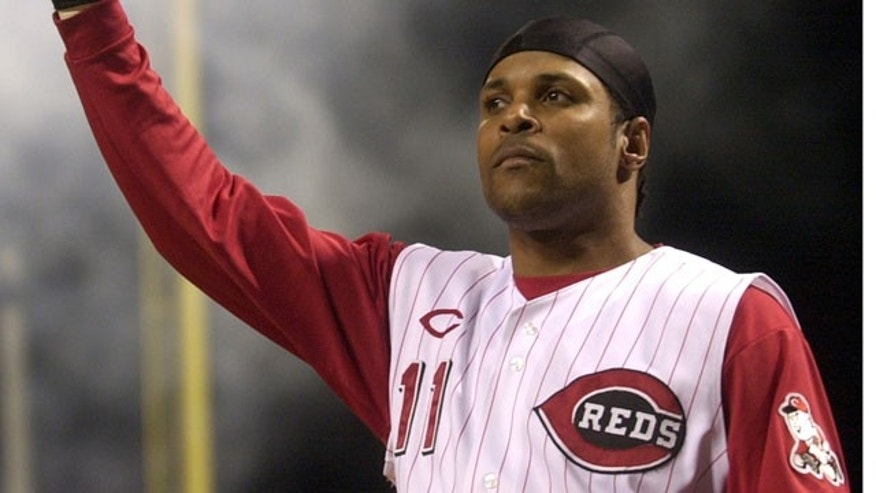 In this July 28, 2004 file photo, Cincinnati Reds' Barry Larkin takes a curtain call after hitting a pinch-hit grand slam off St. Louis Cardinals pitcher Steve Kline in the fifth inning,in Cincinnati. Larkin has been elected to baseball's Hall of Fame.