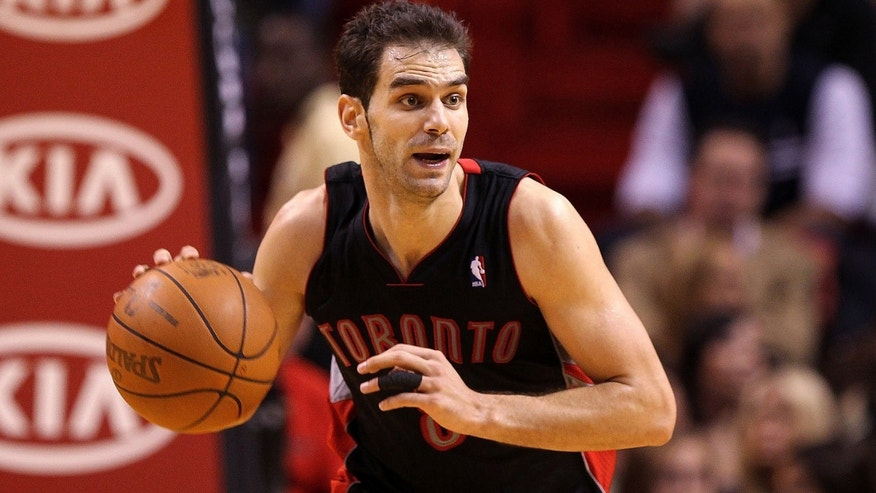 MIAMI, FL - JANUARY 22:  Jose Calderon #8 of the Toronto Raptors dribbles the ball during a game against the Miami Heat at American Airlines Arena on January 22, 2011 in Miami, Florida. NOTE TO USER: User expressly acknowledges and agrees that, by downloading and/or using this Photograph, User is consenting to the terms and conditions of the Getty Images License Agreement.  (Photo by Mike Ehrmann/Getty Images) *** Local Caption *** Jose Calderon