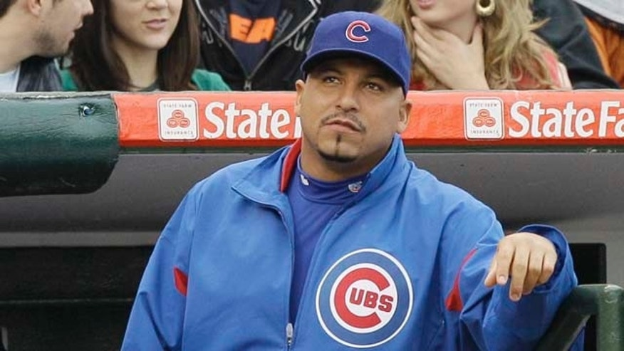 Chicago Cubs pitcher Carlos Zambrano looks to fans during the ninth inning of a baseball game against the Pittsburgh Pirates, Sunday, May 29, 2011, in Chicago. The Cubs won 3-2. (AP Photo/Nam Y. Huh)