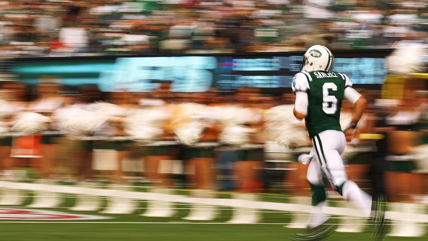 EAST RUTHERFORD, NJ - NOVEMBER 27:   Mark Sanchez #6 of the New York Jets runs onto the field before the game against the Buffalo Bills during their pre season game on November 27, 2011 at  MetLife Stadium in East Rutherford, New Jersey.  (Photo by Al Bello/Getty Images)
