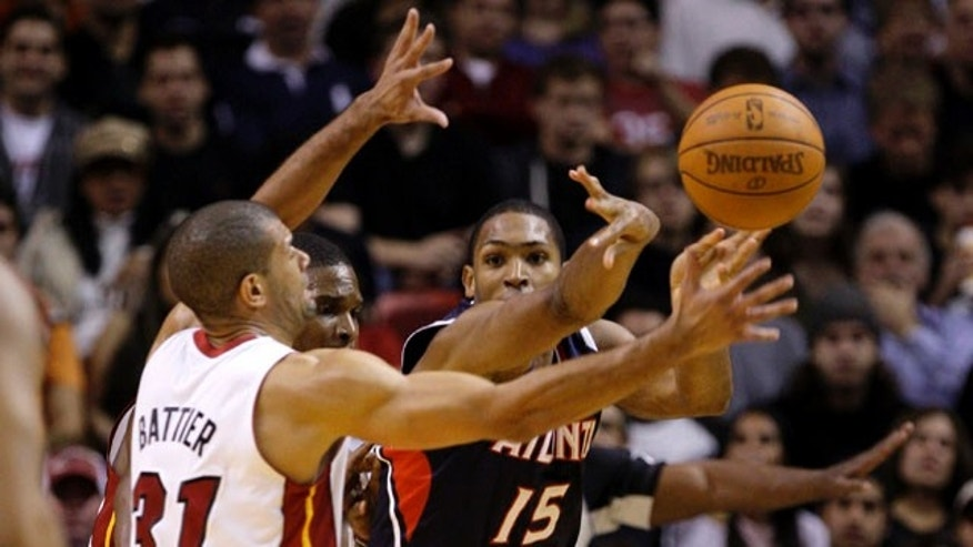 Atlanta Hawks' Al Horford (15) passes the ball as Miami Heat's Shane Battier (31) defends during the first half of an NBA basketball game, Monday, Jan. 2, 2012, in Miami. (AP Photo/Lynne Sladky)