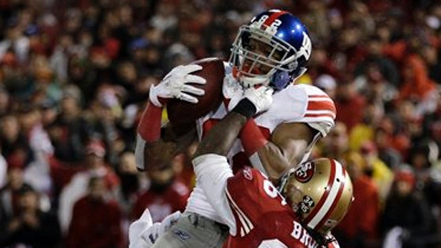 January 22, 2012: New York Giants' Mario Manningham catches a touchdown pass in front of San Francisco 49ers' Tramaine Brock (26) during the second half of the NFC Championship NFL football game.