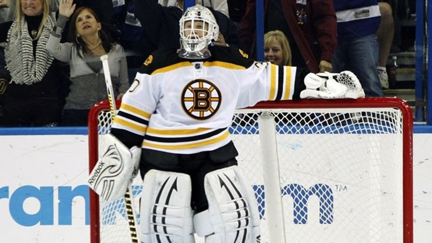 January 17, 2012: Boston Bruins goalie Tim Thomas reacts after giving up a goal to Tampa Bay Lightning center Dominic Moore during the third period of an NHL hockey game in Tampa, Fla.