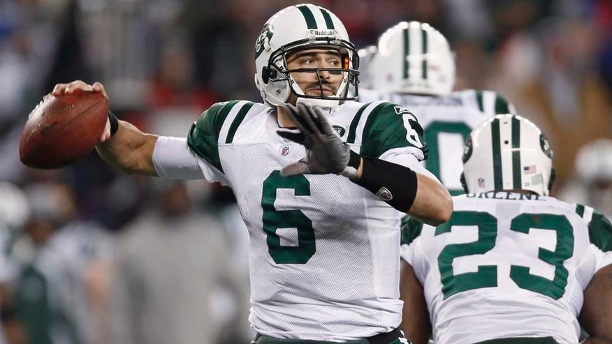 New York Jets quarterback Mark Sánchez prepares to pass against the New England Patriots during the second half of an NFL divisional football playoff game in Foxborough, Mass., Sunday, Jan. 16, 2011. (AP Photo/Winslow Townson)