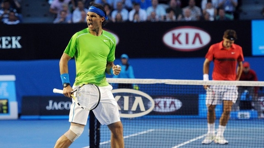 Jan. 26, 2012: Spain's Rafael Nadal, left, celebrates a point win against Switzerland's Roger Federer during their semifinal at the Australian Open tennis championship, in Melbourne, Australia.