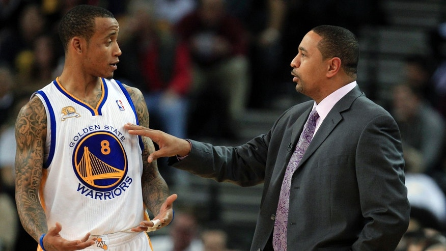 Golden State Warriors coach Mark Jackson talks to Monta Ellis as the Warriors played the Orlando Magic during the first half of an NBA basketball game in Oakland, Calif., Thursday, Jan. 12, 2012. (AP Photo/Marcio Jose Sanchez)