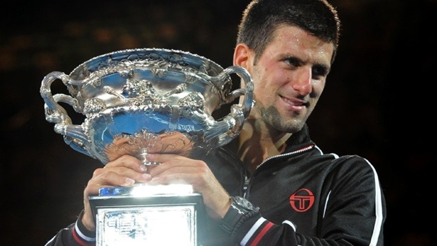 Jan. 30, 2012: Novak Djokovic of Serbia holds  the trophy during the awarding ceremony after defeating Rafael Nadal of Spain  in the men's singles final at the Australian Open tennis championship, in Melbourne, Australia.