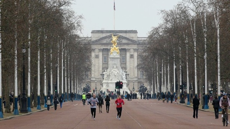 Jan. 29: People jog down the Mall from Buckingham Palace in London.