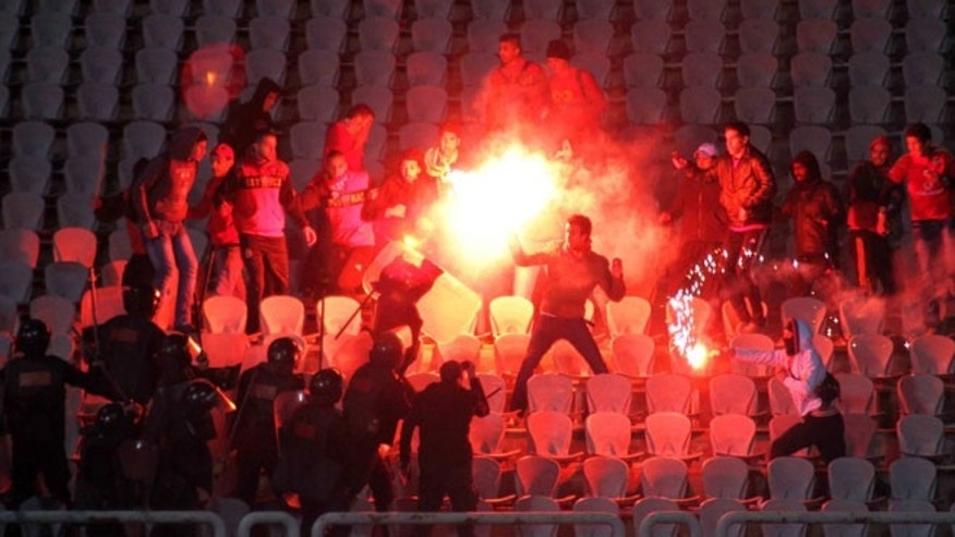 Egyptian fans clash with riot police following Al-Ahly club soccer match against Al-Masry club at the soccer stadium in Port Said, Egypt Wednesday, Feb. 1, 2012.  (AP Photo)