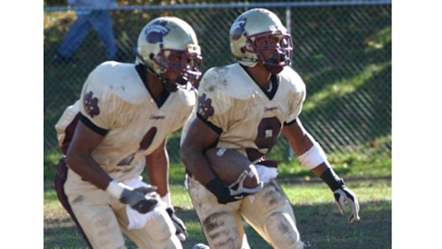 Victor Cruz, right, playing in high school for the Paterson Catholic Cougars.
