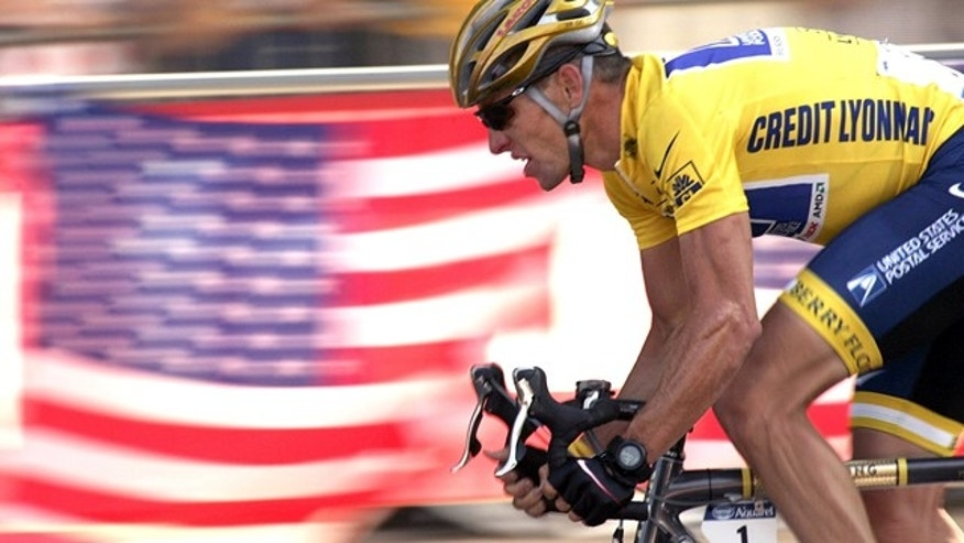 FILE 2004: Lance Armstrong rides down the Champs Elysees avenue during the 20th and last stage of the Tour de France cycling race between Montereau, southeast of Paris, and the Champs-Elysees in Paris.