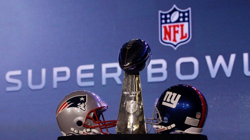 The Vince Lombardi Trophy is seen during a news conference for NFL football's Super Bowl XLVI Friday, Feb. 3, 2012, in Indianapolis. (AP Photo/David J. Phillip)
