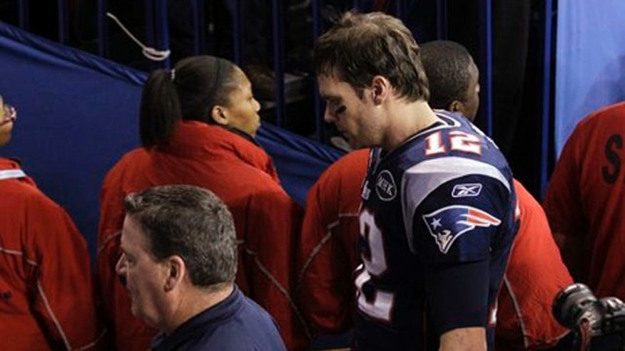 Feb. 5, 2012: New England Patriots quarterback Tom Brady leaves the field after Super Bowl loss.