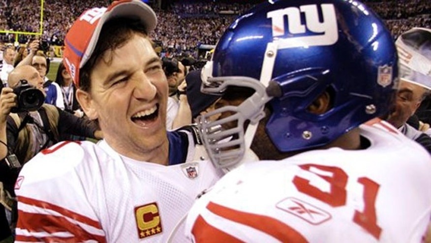 Feb. 5, 2012: New York Giants quarterback Eli Manning, left, and Aaron Ross celebrate their team's 21-17 win.
