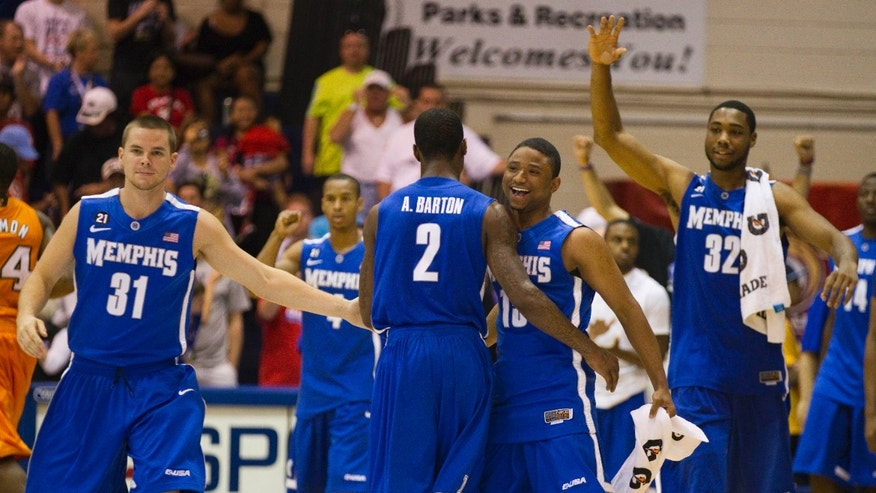 FILE - In this Nov. 22, 2011, file photo, Memphis' Preston Laird (31), Antonio Barton (2), Trey Draper, right center, and  Stan Simpson (32) celebrate their double overtime win in a NCAA college basketball game against Tennessee, in Lahaina, Hawaii.