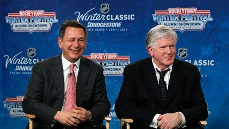 Feb. 9, 2012: Detroit Red Wings general manager Ken Holland, left, and Toronto Maple Leafs President & General Manager Brian Burke speak at a news conference to announce the NHL Winter Classic hockey game at Comerica Park in Detroit. The Toronto Maple Leafs will play the Detroit Red Wings at Michigan Stadium in Ann Arbor, Mich., on Jan. 1, 2013.