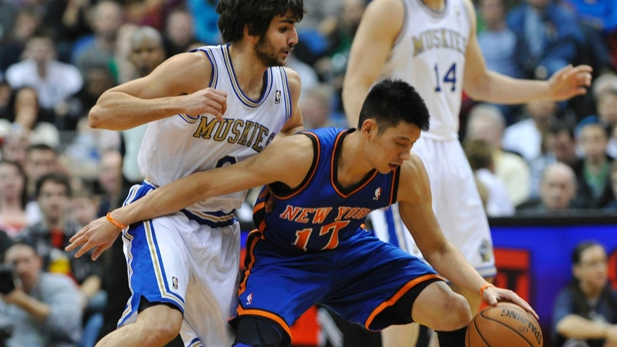 New York Knicks' Jeremy Lin, right, keeps the ball out of reach of Minnesota Timberwolves' Ricky Rubio, of Spain, in the first half of an NBA basketball game on Saturday, Feb. 11, 2012, in Minneapolis. The Timberwolves wore throwback uniforms from the 1967 Minnesota Muskies team. (AP Photo/Jim Mone)