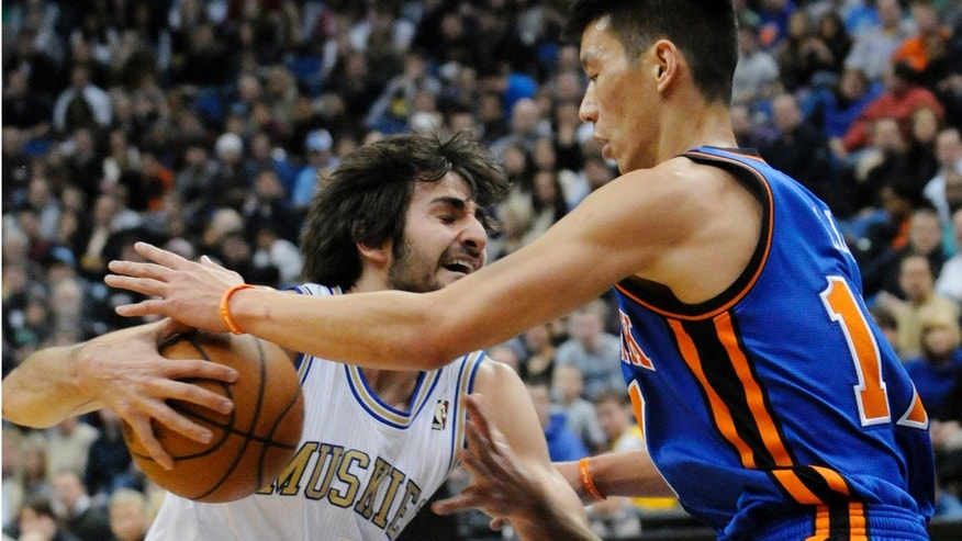 New York Knicks' Jeremy Lin, right, reaches for the ball as Minnesota Timberwolves' Ricky Rubio, of Spain, drives in the first half of an NBA basketball game on Saturday, Feb. 11, 2012, in Minneapolis. The Timberwolves wore throwback uniforms from the 1967 Minnesota Muskies team. (AP Photo/Jim Mone)