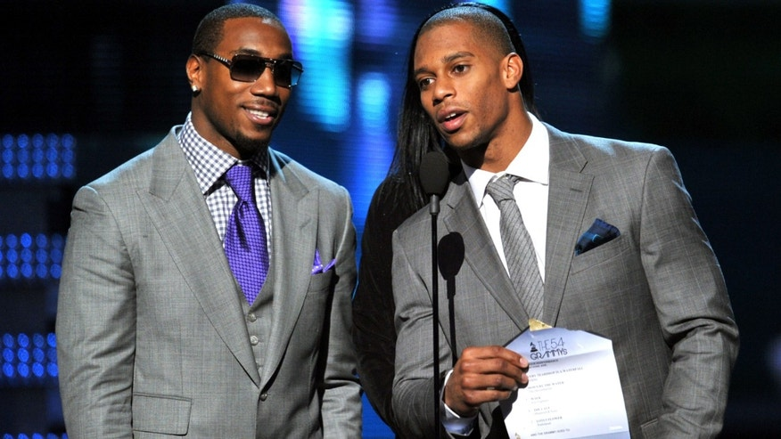 LOS ANGELES, CA - FEBRUARY 12:  NFL players Mario Manningham (L) and Victor Cruz of the New York Giants performs onstage at the 54th Annual GRAMMY Awards held at Staples Center on February 12, 2012 in Los Angeles, California.  (Photo by Kevin Winter/Getty Images)