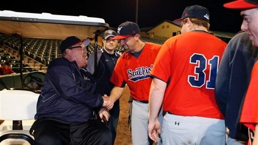 Feb. 2: Hall of Fame catcher and Palm Beach Atlantic University coach Gary Carter, left, greets players on the field before PBAU's baseball home opener at Roger Dean Stadium in Jupiter, Florida.