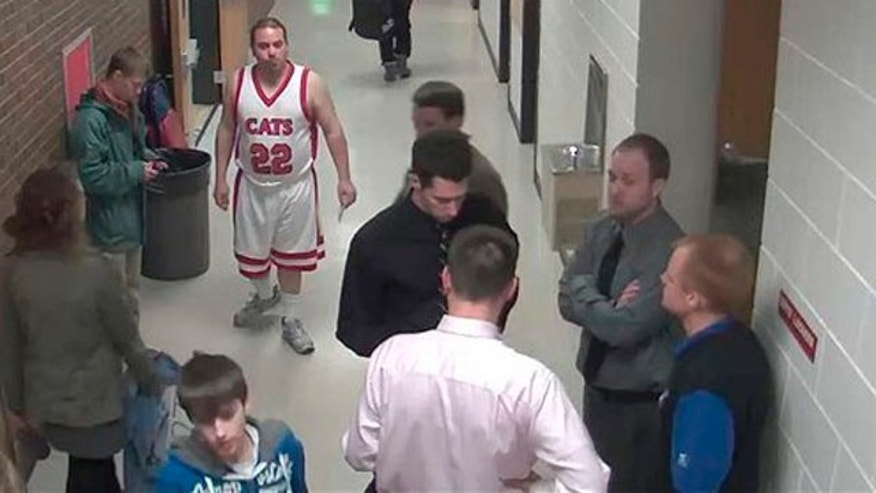 Feb. 4, 2012: In this photo taken from security camera footage provided by Bismarck Schools, a man identified as 28-year-old Sherwin Shayegan of Bothell, Wash., dressed in a basketball uniform, stands in a hallway at Century High School in Bismarck, N.D.