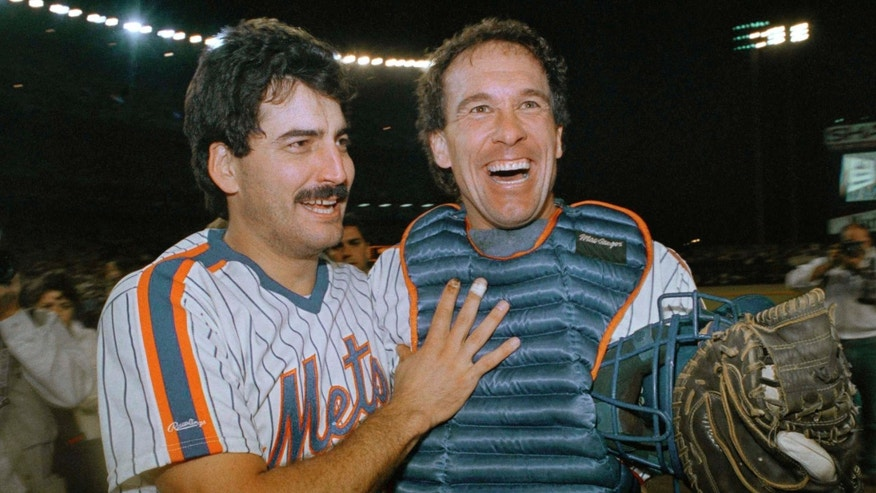 FILE - In this Sept. 23, 1988, file photo, New York Mets' Keith Hernandez, left, and Gary Carter are happy-looking ball players as they come off the field at Shea Stadium in New York after clinching the National League East title. Baseball Hall of Fame president Jeff Idelson said Thursday, Feb. 16, 2012, that Hall of Fame catcher Gary Carter has died.(AP Photo/Peter Morgan, File)