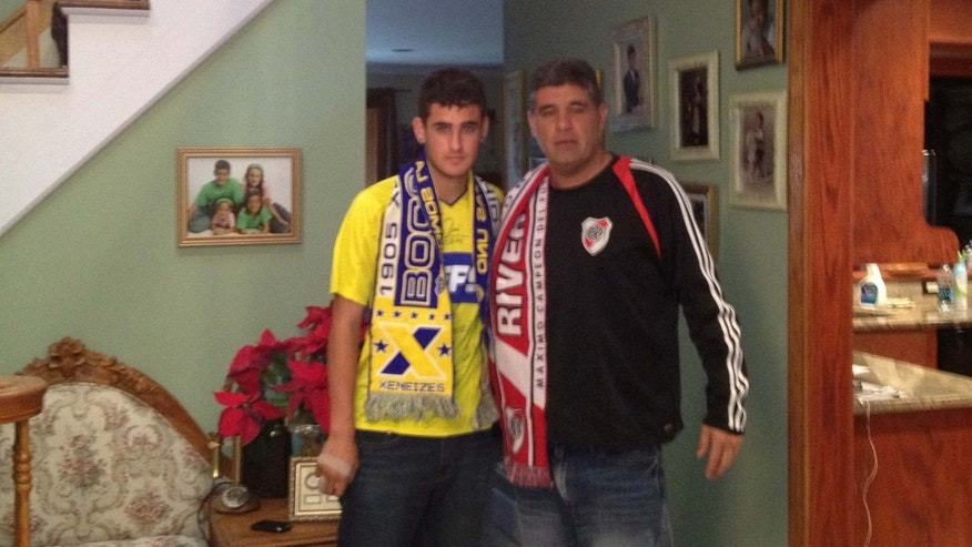 Photo of Nicholas (left) and Adrian Gaitan wearing the colors of their favorite Argentine clubs.Nicholas is a Boca Juniors fans, Adrian a River Plate supporter. Photo courtesy of the Gaitan family
