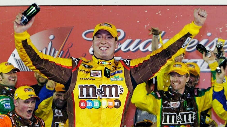 Kyle Busch celebrates in victory lane after winning the NASCAR Budweiser Shootout auto race at Daytona International Speedway on Saturday in Daytona Beach. (AP Photo/John Raoux)