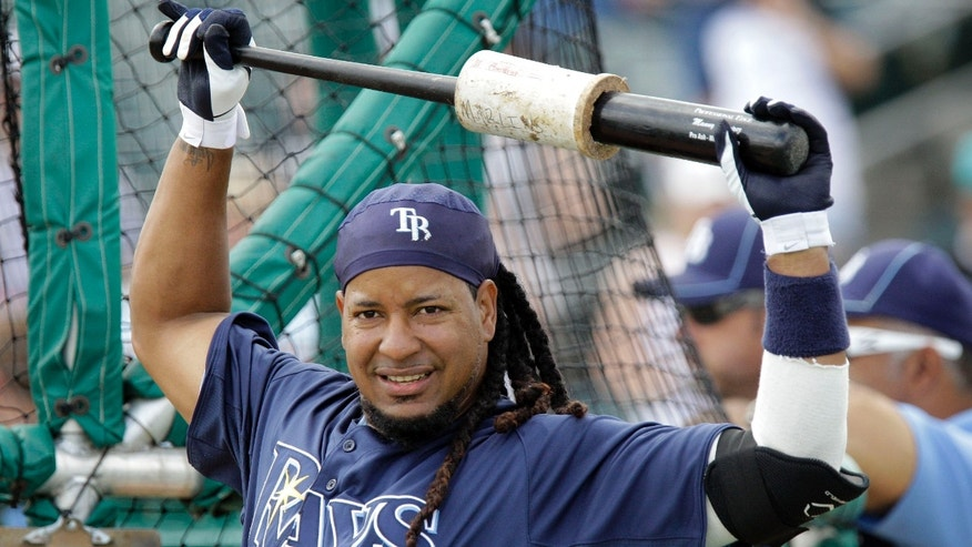 FILE - In this March 16, 2011, file photo, Tampa Bay Rays' Manny Ramirez warms up before a spring training baseball game against the Florida Marlins in Jupiter, Fla. The Oakland Athletics still have strong interest in signing Ramirez, who presents a low-risk investment for the rebuilding franchise.  If things come together, and the 39-year-old Ramirez signs a deal, he first must serve a 50-game suspension for violating baseball's drug policy before he could play. (AP Photo/File)
