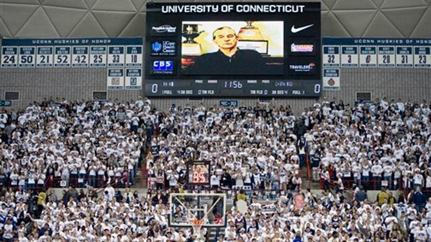Feb. 25, 2012: Connecticut head coach Jim Calhoun addresses fans prior to an NCAA college basketball game against Syracuse in Storrs, Conn.